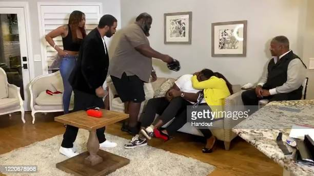 In this still image from video provided by the NFL Mekhi Becton third from right is hugged after being selected by the New York Jets during the first...