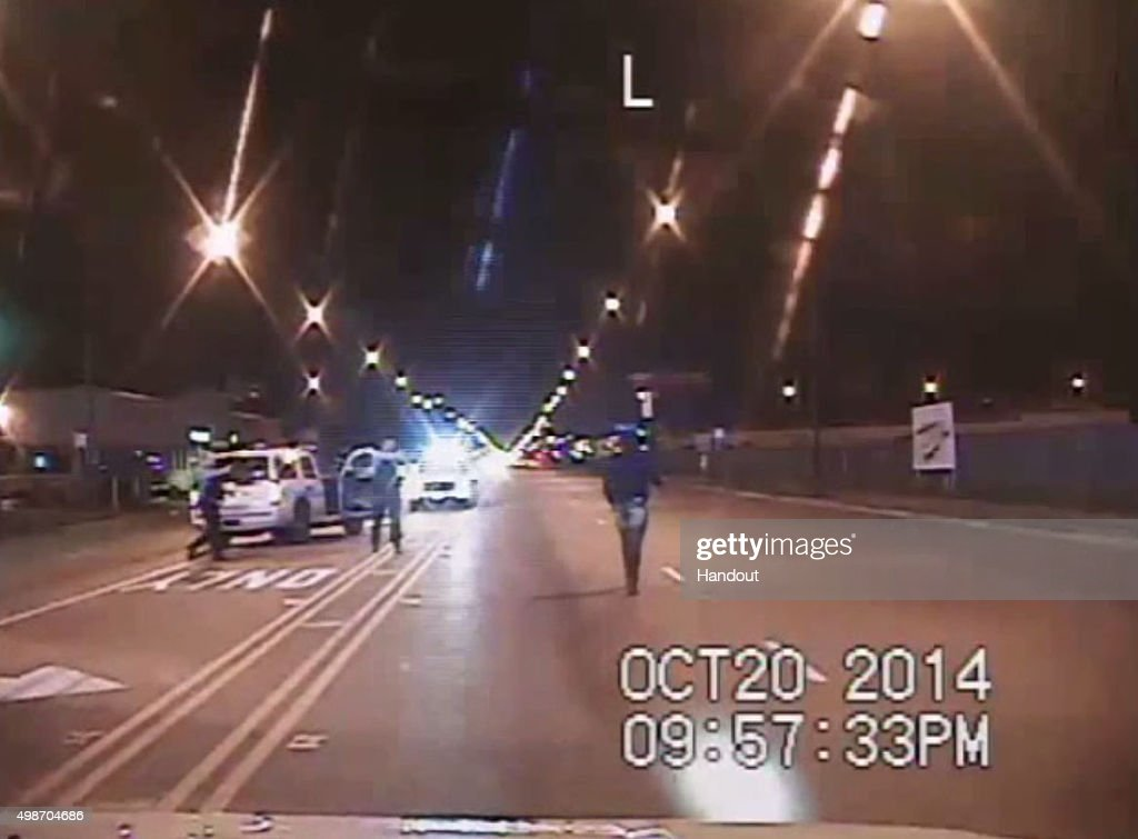 In this still image taken from a police vehicle dash camera released by the Chicago Police Department on November 24, 2015 , Laquan McDonald walks up a street just prior to being shot by Chicago Police officer Jason Van Dyke on October 20, 2014 in Chicago, Illinois. Officer Van Dyke was charged with first degree murder for the October 20, 2014 shooting in which McDonald was hit with 16 bullets.