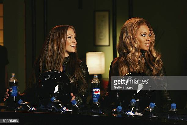 In this still released on February 21 Jennifer Lopez and Beyonce Knowles enjoy a laugh during the filming of a new Pepsi advertisement Set in the...