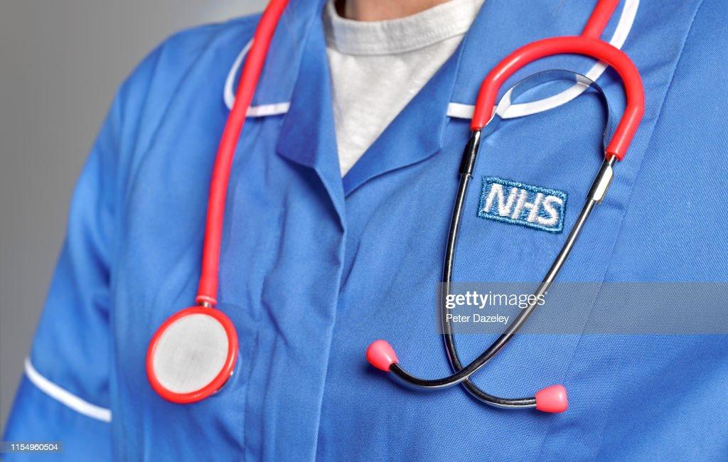 NHS member of staff wearing uniform : News Photo