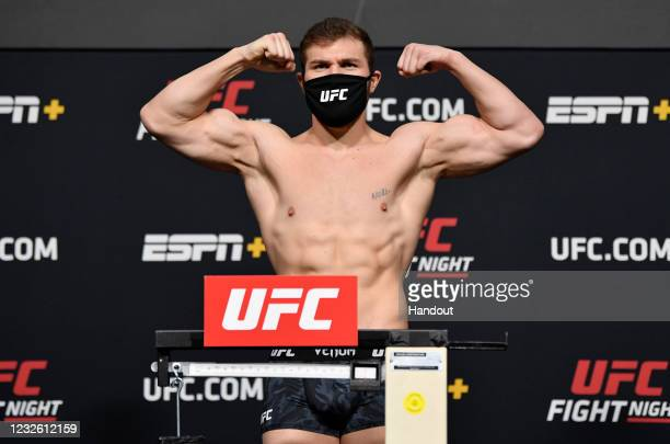 In this UFC handout, Ion Cutelaba of Moldova poses on the scale during the UFC weigh-in at UFC APEX on April 30, 2021 in Las Vegas, Nevada.