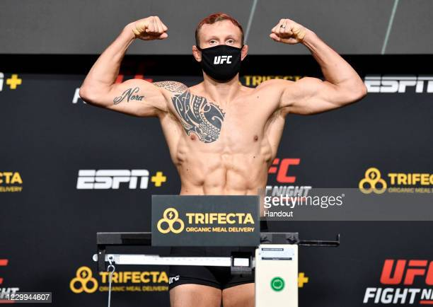 In this UFC handout, Jack Hermansson of Sweden poses on the scale during the UFC Fight Night weigh-in at UFC APEX on December 04, 2020 in Las Vegas,...