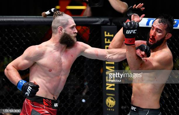 In this UFC handout, Jiri Prochazka of the Czech Republic punches Dominick Reyes in a light heavyweight bout during the UFC Fight Night event at UFC...