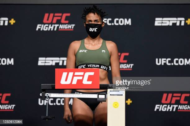 In this UFC handout, Luana Carolina of Brazil poses on the scale during the UFC weigh-in at UFC APEX on April 30, 2021 in Las Vegas, Nevada.