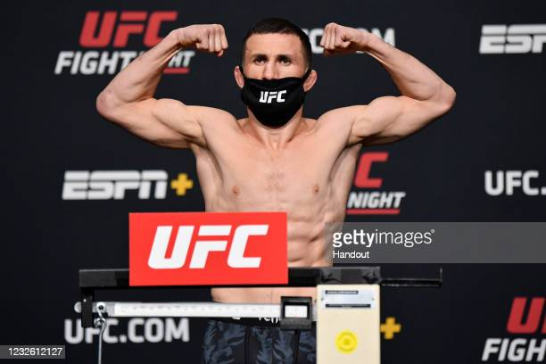In this UFC handout, Merab Dvalishvili of Georgia poses on the scale during the UFC weigh-in at UFC APEX on April 30, 2021 in Las Vegas, Nevada.