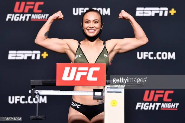 In this UFC handout, Michelle Waterson poses on the scale during the UFC weigh-in at UFC APEX on May 07, 2021 in Las Vegas, Nevada.
