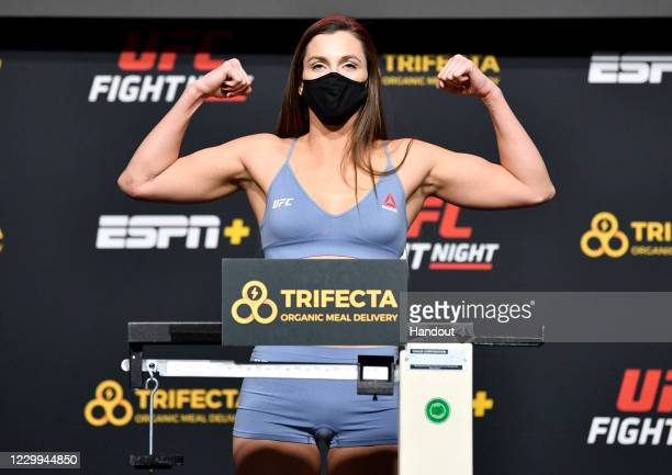 In this UFC handout, Montana De La Rosa poses on the scale during the UFC Fight Night weigh-in at UFC APEX on December 04, 2020 in Las Vegas, Nevada.