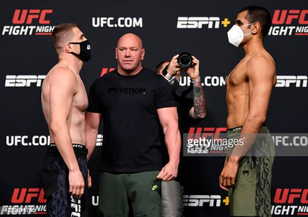 In this UFC handout, Opponents Andreas Michailidis of Greece and KB Bhullar of Canada face off during the UFC weigh-in at UFC APEX on April 30, 2021...