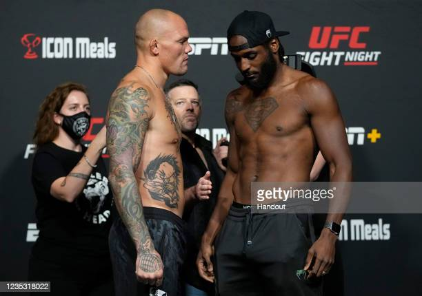 In this UFC handout, Opponents Anthony Smith and Ryan Spann face off during the UFC Fight Night weigh-in at UFC APEX on September 17, 2021 in Las...