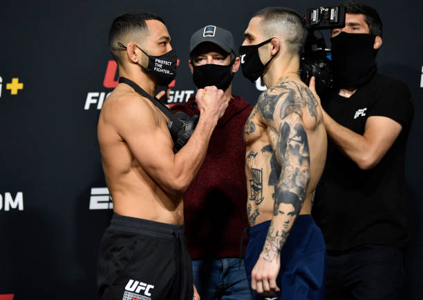 In this UFC handout, Opponents Dan Ige and Gavin Tucker of Canada face off during the UFC weigh-in at UFC APEX on March 12, 2021 in Las Vegas, Nevada.
