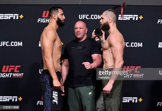 In this UFC handout, Opponents Dominick Reyes and Jiri Prochazka of the Czech Republic face off during the UFC weigh-in at UFC APEX on April 30, 2021...