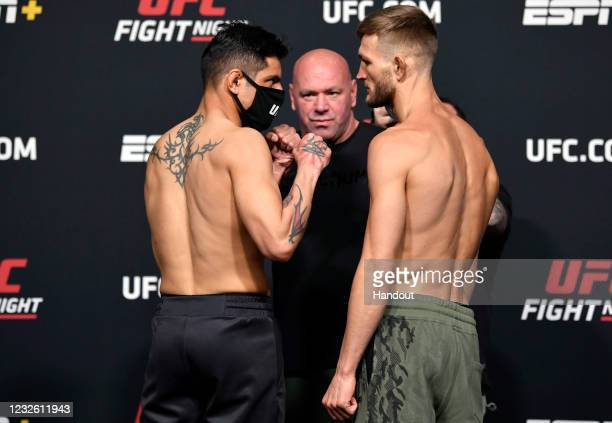 In this UFC handout, Opponents Gabriel Benitez of Mexico and Jonathan Pearce face off during the UFC weigh-in at UFC APEX on April 30, 2021 in Las...