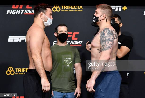 In this UFC handout, Opponents Gian Villante and Jake Collier face off during the UFC Fight Night weigh-in at UFC APEX on December 04, 2020 in Las...