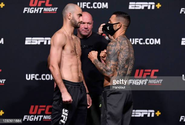 In this UFC handout, Opponents Giga Chikadze of Georgia and Cub Swanson face off during the UFC weigh-in at UFC APEX on April 30, 2021 in Las Vegas,...