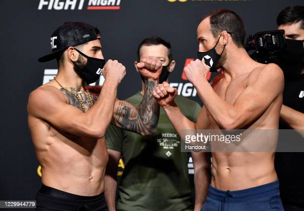 In this UFC handout, Opponents Ilia Topuria of Germany and Damon Jackson face off during the UFC Fight Night weigh-in at UFC APEX on December 04,...