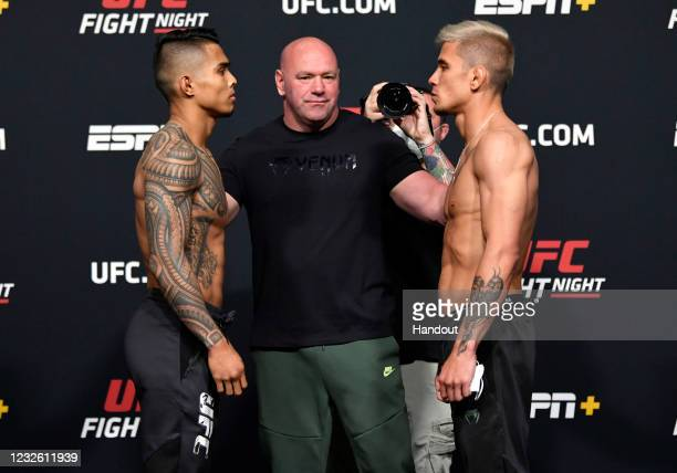 In this UFC handout, Opponents Kai Kamaka and TJ Brown face off during the UFC weigh-in at UFC APEX on April 30, 2021 in Las Vegas, Nevada.