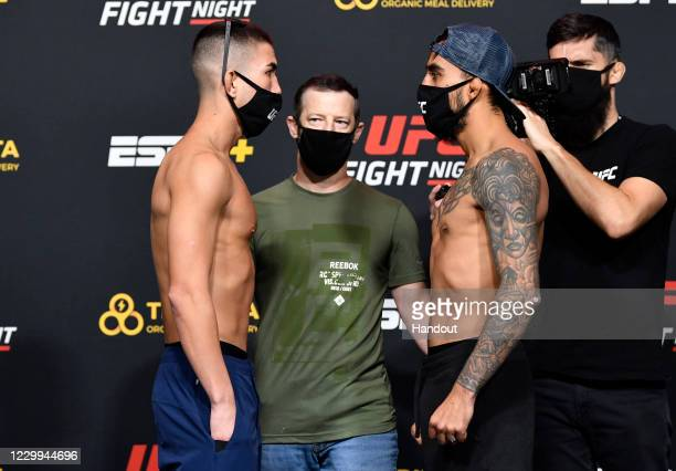 In this UFC handout, Opponents Louis Smolka and Jose Quinonez of Mexico face off during the UFC Fight Night weigh-in at UFC APEX on December 04, 2020...