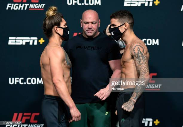 In this UFC handout, Opponents Luke Sanders and Felipe Colares of Brazil face off during the UFC weigh-in at UFC APEX on April 30, 2021 in Las Vegas,...
