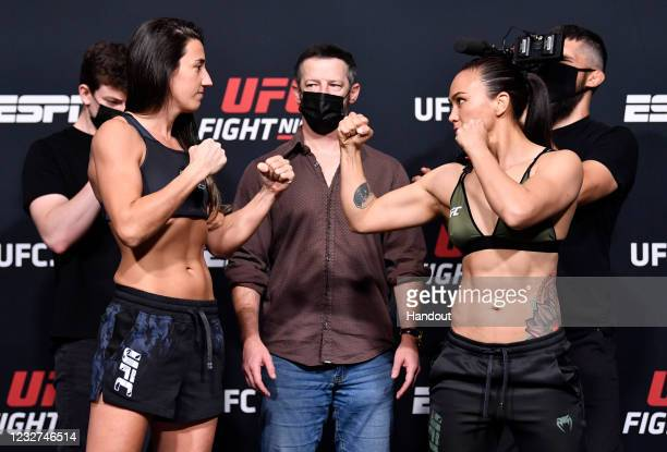 In this UFC handout, Opponents Marina Rodriguez of Brazil and Michelle Waterson face off during the UFC weigh-in at UFC APEX on May 07, 2021 in Las...