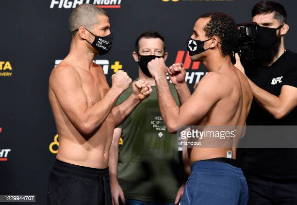 In this UFC handout, Opponents Matt Wiman and Jordan Leavitt face off during the UFC Fight Night weigh-in at UFC APEX on December 04, 2020 in Las...