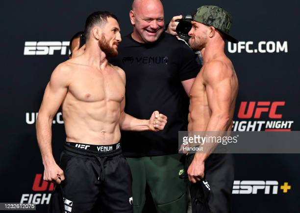 In this UFC handout, Opponents Merab Dvalishvili of Georgia and Cody Stamann face off during the UFC weigh-in at UFC APEX on April 30, 2021 in Las...