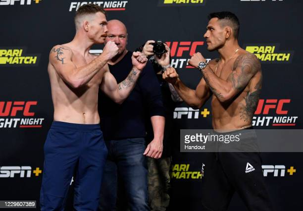 In this UFC handout, Opponents Paul Felder and Rafael Dos Anjos of Brazil face off during the UFC weigh-in at UFC APEX on November 13, 2020 in Las...