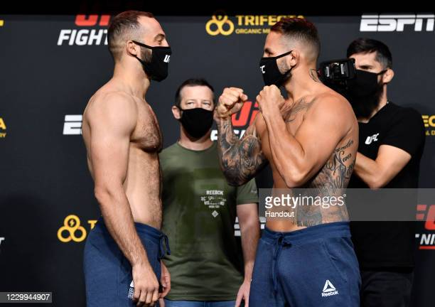 In this UFC handout, Opponents Roman Dolidze of Georgia and John Allan face off during the UFC Fight Night weigh-in at UFC APEX on December 04, 2020...
