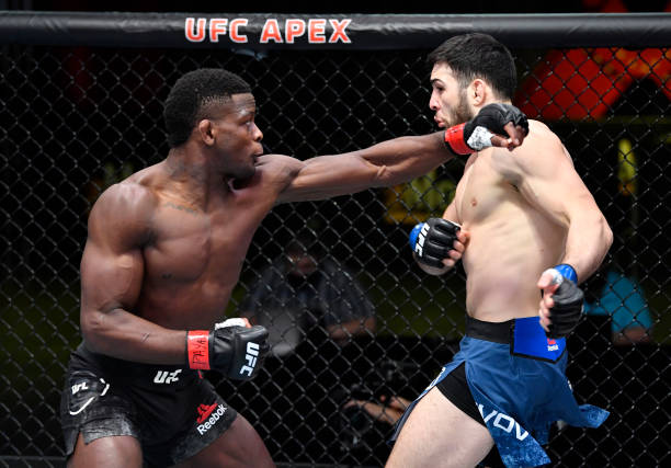 In this UFC handout, Phil Hawes punches Nassourdine Imavov of Russia in a middleweight bout during the UFC Fight Night event at UFC APEX on February...