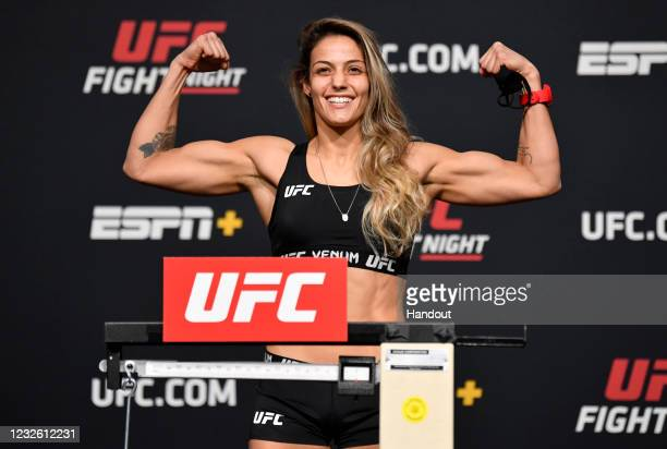 In this UFC handout, Poliana Botelho of Brazil poses on the scale during the UFC weigh-in at UFC APEX on April 30, 2021 in Las Vegas, Nevada.