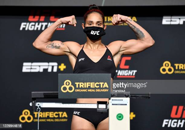 In this UFC handout, Taila Santos of Brazil poses on the scale during the UFC Fight Night weigh-in at UFC APEX on December 04, 2020 in Las Vegas,...