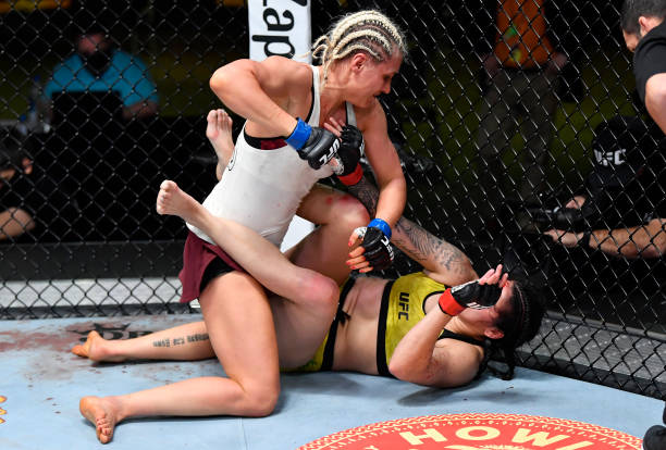 In this UFC handout, Yana Kunitskaya of Russia punches Ketlen Vieira of Brazil in a bantamweight bout during the UFC Fight Night event at UFC APEX on...