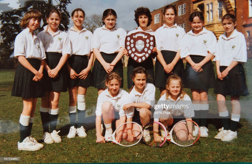 In this undated collect photo provided by St Andrew's School, Kate Middleton (back row, 3rd L) is pictured in a tennis team photo during her time as a pupil at St Andrew's School in Pangbourne, Berkshire, England (1986-1995). Catherine, Duchess of Cambridge re-visited her former school on November 30, 2012 to take part in a day of activities and festivities to mark the occasion of St Andrew's Day. The Duchess visited the Pre-Prep School for under-5s, unveiled a plaque to officially open a new artificial turf playing field and met members of the school's hockey team, which she played for during her time as a pupil at the school. She was also given a private tour of the school and watched the school's Progressive Games which are traditional games played indoors by teachers and students on St Andrew's Day.
