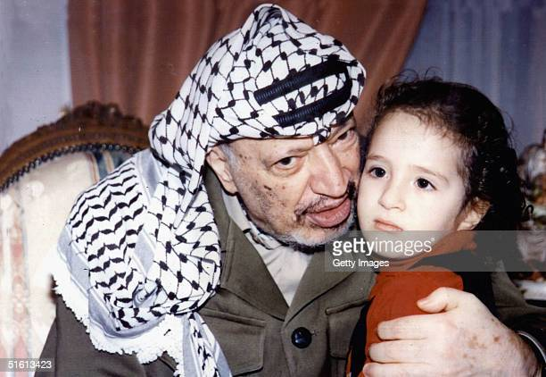 In this undated handout from the Palestinian Authorities Palestinian leader Yasser Arafat is pictured at play with hid daughter Zahwa Medics...
