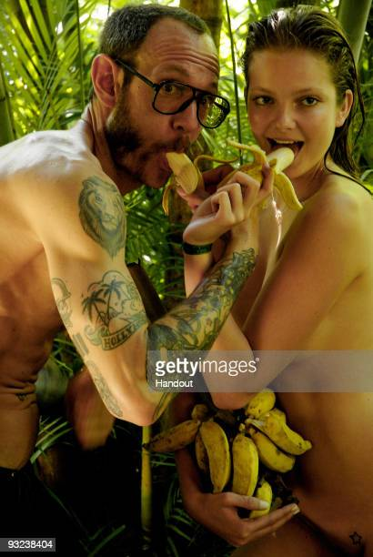 In this undated handout image provided by Pirelli model Enriko Mihalik and photographer Terry Richardson pose during the creation of the new 2010...