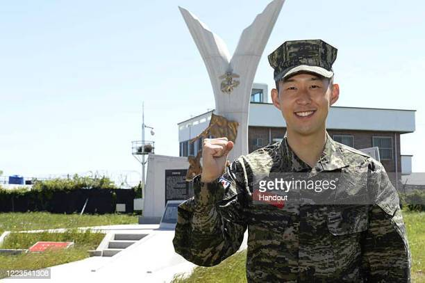 In this undated handout image provided by Republic of Korea Marine Corps' official Facebook page, Tottenham Hotspur forward Son Heung-min poses for a...