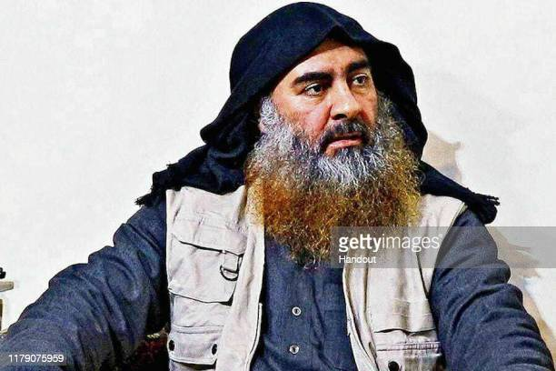 In this undated handout image provided by the Department of Defense ISIS leader Abu Bakr alBaghdadi is seen in an unspecified location On October 26...