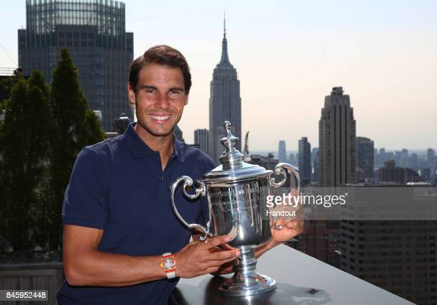 In this undated handout image Rafael Nadal of Spain the 2017 US Open Men's Singles champion poses with the winner's trophy in New York City