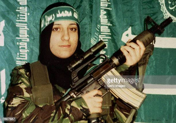 In this undated handout image Reem Slaleh Raiyshi a mother of two children from Gaza stands holding a gun Raiyshi was named as the woman who blew...