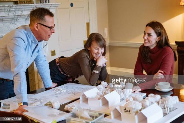 In this undated handout image supplied by Kensington Palace Catherine Duchess of Cambridge with Andree Davies and Adam White of Davies White...