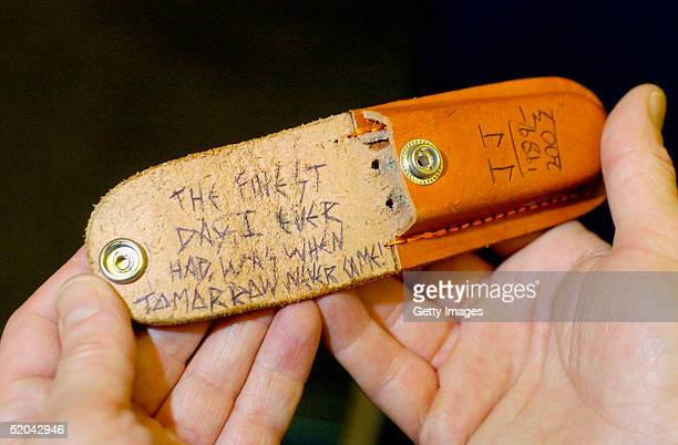 """In this undated handout issued by Lothian and Borders Police Luke Mitchells Knife pouch with the words """"The finest day I ever had was when tomorrow..."""