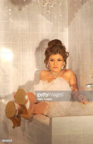 UNDATED In this undated handout photo American Idol winner Kelly Clarkson poses for a new advertising campaign for Candie's shoes Actress Jenny...
