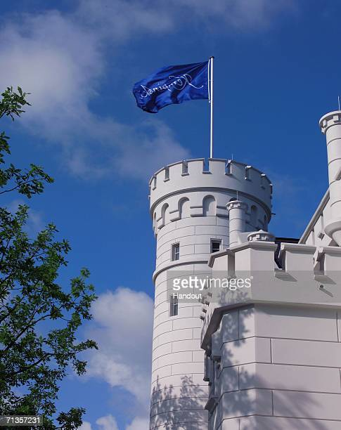 In this undated handout photo from Kempinski issued on July 3 a flag bearing the Kempinski logo flies over the Hohenzollern Castle part of the...