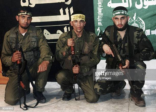 In this undated handout photo from the Fatah movement Palestinian militants Meqdad AlMobayed of the Islamic Jihad military wing Alquds Brigade Omar...
