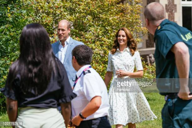 In this undated handout photo issued on July 23, 2020 by Kensington Palace, Prince William, Duke of Cambridge and Catherine, Duchess of Cambridge...