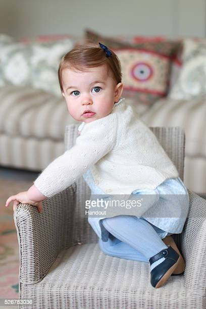 In this undated handout photo provided by HRH The Duke and Duchess of Cambridge released on May 1 Princess Charlotte of Cambridge looks up on a chair...