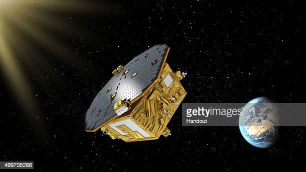 In this undated handout photo provided by the European Space Agency an artist's impression shows the LISA Pathfinder orbiting over the Earth ESA...