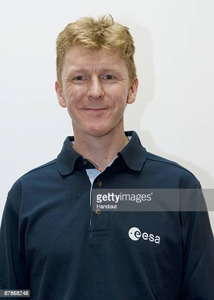 ONLY*** In this undated handout photo provided by the European Space Agency Timothy Peake poses for a photograph at ESA Headquarters in Paris France...