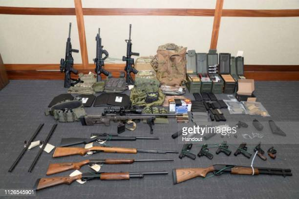In this undated handout photo provided by US Attorney's Office for the District of Maryland the collection of weapons and ammunition federal agents...