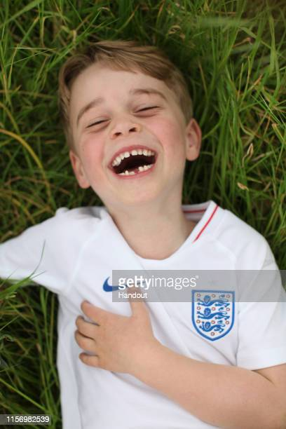 In this undated handout photo released by the Duke and Duchess of Cambridge, Prince George of Cambridge is photographed recently in the garden of...