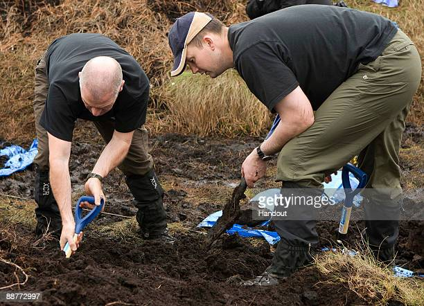 In this undated handout photo supplied by the Greater Manchester Police a police search team looks for the body of Moors murder victim Keith Bennett...